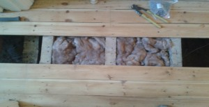 A section of the same hallway after the insulation material has been cut to size and installed.